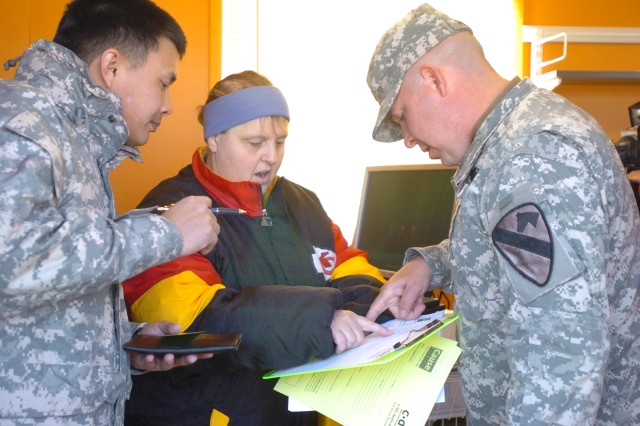 Sgt. Keith Eldridge, Company D, 1st Battalion, Warrior Transition Brigade, registers to use C*DEL as CAUSE volunteer Cecilia Clarkson and Staff Sgt. Brent Homan, Company A, 1st Battalion, Warrior Transition Brigade, assist him. C*DEL is a video and gaming library, which was donated recently to Fort Hood's wounded warriors by Comfort for America's Uniformed Services (CAUSE), a 501(c)(3) nonprofit.