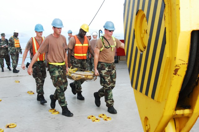 CHUK SAMET, Thailand (Feb. 3, 2009) - Sailors aboard the Maritime Prepositioning Ship S.S. Maj. Stephen W. Pless participate in a mock casualty evacuation prior to the start of exercise Cobra Gold 2009. Cobra Gold is an annual Thailand and U.S. co-sponsored joint coalition multinational military exercise designed to train a Thai, U.S. and Singaporean Coalition Task Force. The exercise will also include humanitarian civic action projects with participating nations from Indonesia, Japan, Singapore, Thailand, and the U.S., and a U.S. Thai military field training exercise. Exercise Cobra Gold provides unique and dynamic training opportunities for participating military partners, while promoting relationship building between militaries and local communities.
