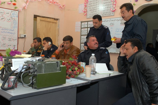 Iraqi Army, Iraqi Police, Salah ad-Din provincial election officials and Coalition forces monitor security operations for the Jan. 31 provincial elections at the Bayji Joint Coordination Center. Thirty-five schools in Bayji were designated as voting sites, and Iraqi Policemen provided security at each location. (U.S. Army photo by Spc. Jazz Burney, 3rd Infantry Brigade Combat Team Public Affairs, 25th Inf. Div.)