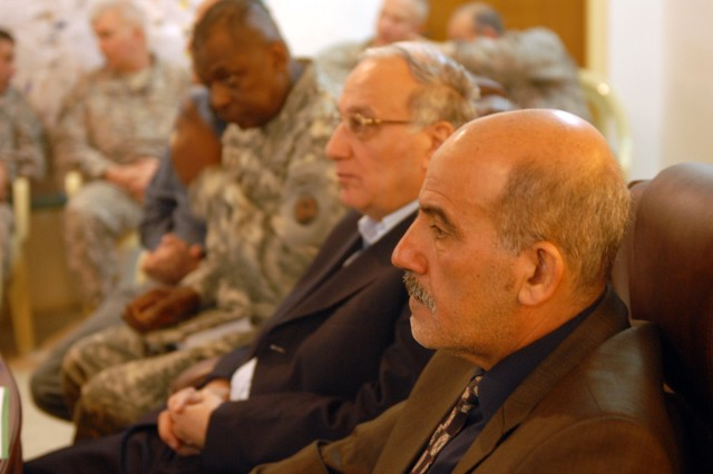 Diyala governor Ra'ad al'Tamimi, Abd A-Qadir Al-Mufriji, the Iraqi Minister of Defense and Lt. Gen. Lloyd Austin, Commander, Multi-national Corps Iraq, discuss the success of Election Day during a meeting while at the Diyala Governance Center in Iraq, Jan. 31. (U.S. Army photo by Pfc. Alisha Nye, 14th Public Affairs Detachment)