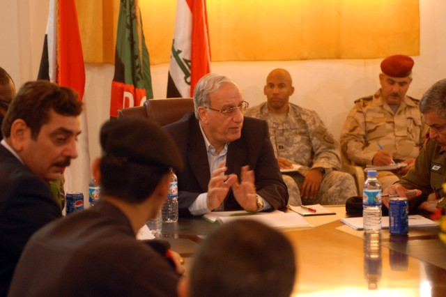 Abd A-Qadir Al-Mufriji, the Iraqi Minister of Defense, addresses Coalition Force and Iraqi government leaders about Election Day, while at the Diyala Governance Center in Iraq, Jan. 31. (U.S. Army photo by Pvt. 1st Alisha Nye, 14th Public Affairs Detachment)
