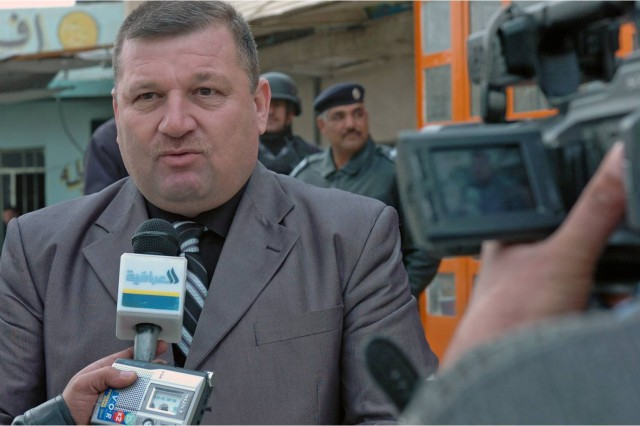 Zuhair Al Araji, the mayor of Mosul is interviewed by local media concerning the day's events. Zuhair said that he was pleased that so many people were voting and at the success of the area's security. Zuhair will remain in office until the mayoral elections, scheduled for August of this year. (Photo by Pfc. Sharla Perrin, 3rd Heavy Brigade Combat Team, 1st Cavalry Division Public Affairs.)