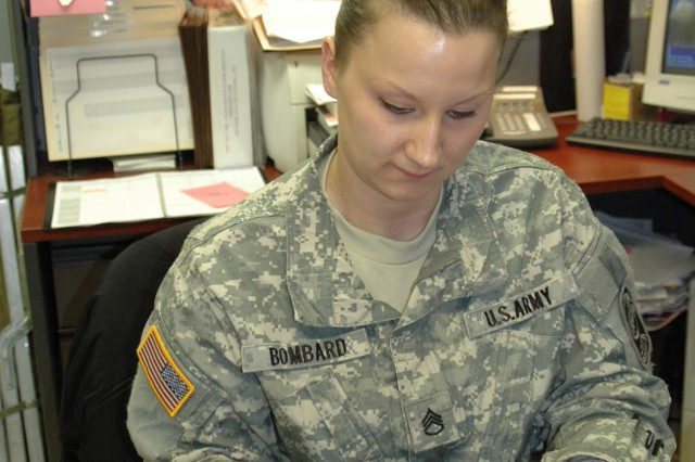 Staff Sgt. Kristine Bombard organizes keys in her supply office at the 100th Missile Defense Brigade (Ground-based Midcourse Defense) Headquarters in Colorado Springs.