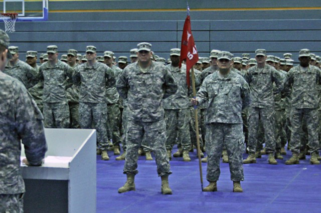 Capt. Clinton Brown speaks to 541st Engineer Company, led in formation by 1st Sgt. Armando Cadena, during a deployment ceremony at the Freedom Fitness Facility Jan. 22 in Bamberg, Germany. The engineer's mission will be to find explosives during route clearance of roads.