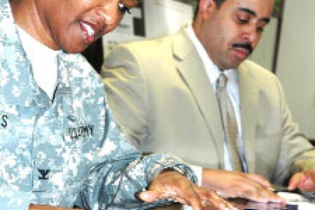 Col. Deborah B. Grays, garrison commander, Fort McPherson and Fort Gillem, Ga., and Joseph Macon, City of East Point mayor, sign a partnership agreement between the two entities Jan. 31, 2009. Under the agreement, which is 10 years old, the two mutually exchange services, resources, facilities, real estate and information.
