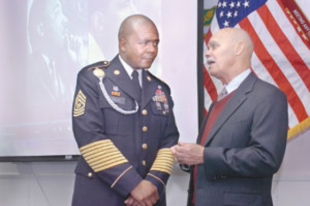 Command Sgt. Maj. James Diggs, North Atlantic Regional Medical Command, talks with Howard Maxwell, former Buffalo Soldier with the 9th Cavalry Regiment. Howard was the guest speaker at DeWitt Army Hospital's observance of Martin Luther King Jr.'s birthday Friday.