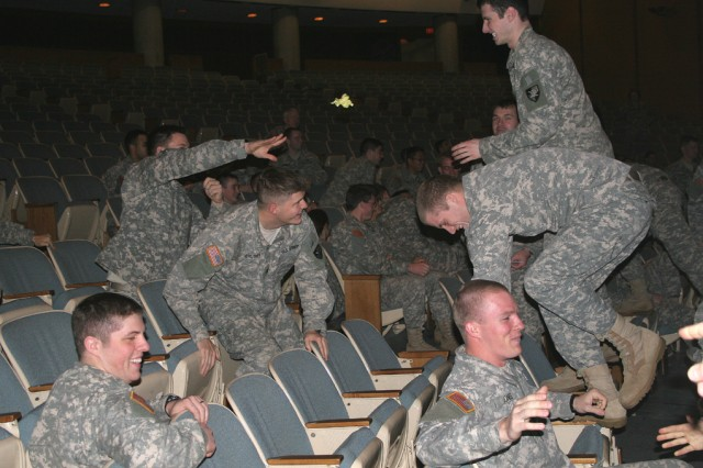 """Attacking cadets are met with a wad of """"machine gun"""" paper during their assault on the trenches in Robinson Auditorium Jan. 28. During the lesson in trench warfare, advancing cadets were only able to step on the arms of the chairs to assault"""