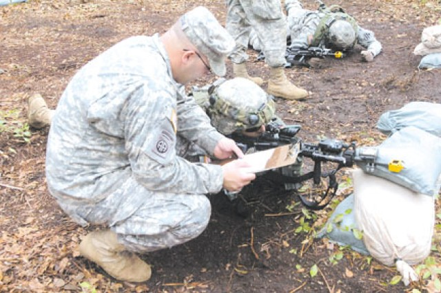 Staff Sergeant Andrew Debastiani, HHC, 2nd BCT, briefs Sgt. Michael Davis, HHC, 1/30th Inf. before Davis begins his run on the 'react to fire' station during the EIB training, Jan. 26 at Marne Obstacle Course.