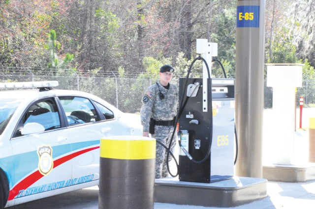 Sergeant Michael Crowley, 293rd Military Police Company, refuels with E85 at Fort Stewart's building 1860.