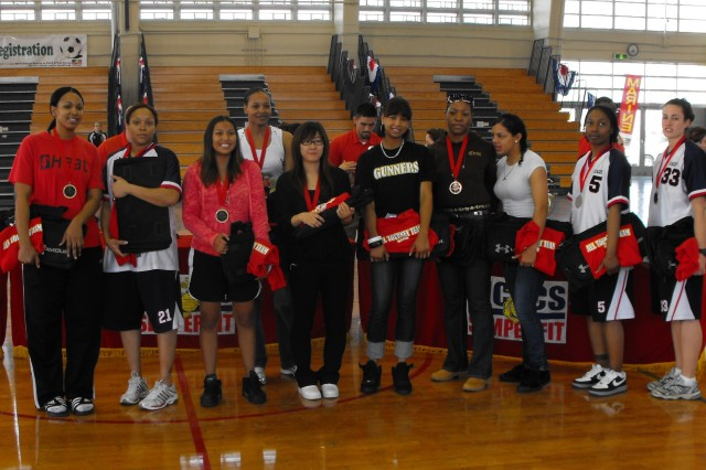 Brandi Dickinson (second from left), Laura Weymon (second from right), Megan Maimone (right) are the USAG-Casey players that made the All Tournament Team which played in the Okinawa MLK Basketball Tournament. - Courtesy photo