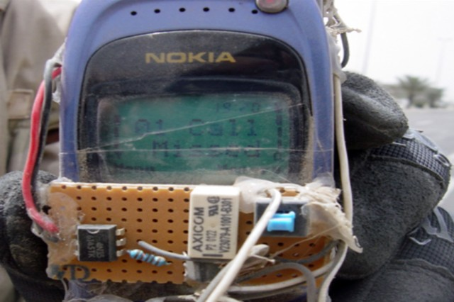 This cell phone was rigged as a detonator for an improvised explosive device.  The detonator was recovered undamaged after having been successfully jammed by electronic warfare personnel using Counter Radio-Controlled IED Electronic Warfare equipment funded by the Joint Improvised Explosive Device Defeat Organization.