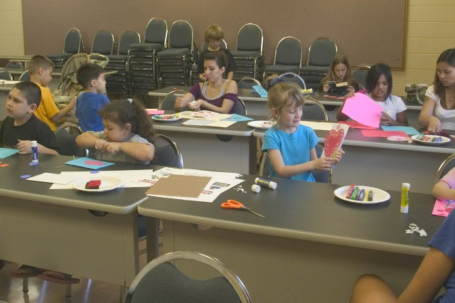 SCHOFIELD BARRACKS, Hawaii - Children and adults showed off their artistic talents by creating a Valentine's Day card for their deployed Soldier during the free Create-a-Card Program at the Sgt. Yano library, recently.