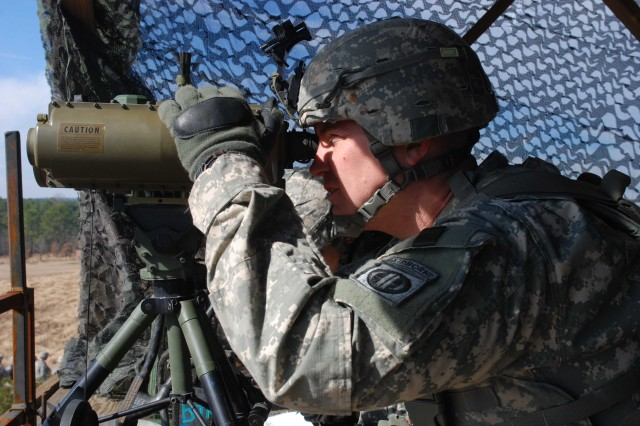 Sgt. 1st Class Matthew Hatfield, the brigade fire support non-commissioned officer for 4th Brigade Combat Team, 82nd Airborne Division uses a Lightweight Laser Locator Designator Range Finder to find the position of a target at an artillery Jan. 23 on Fort Bragg.