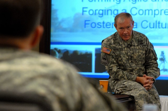 Gen. Martin Dempsey, commander of Training and Doctrine Command, nods toward Lt. Gen. William Caldwell IV, Combined Arms Center and Fort Leavenworth Commander, while talking about getting feedback from leaders of the centers and schools via Caldwell during the CAC Senior Leader Conference Feb. 4, 2009, in Arnold Conference Room at the Lewis and Clark Center at Fort Leavenworth, Kan.