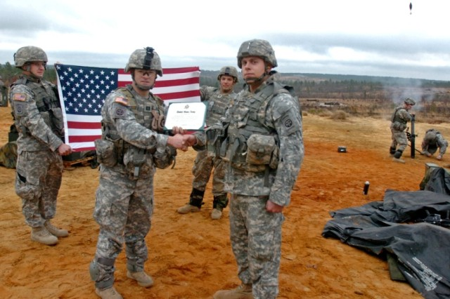 Fort Bragg NCO Re-enlists on mortar range