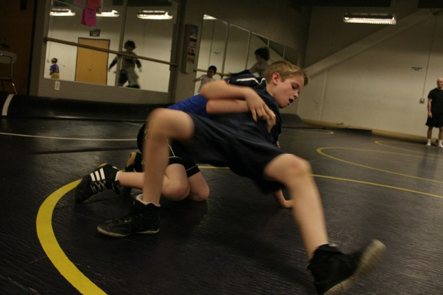 Bradley Wanovich, front, demonstrates his moves on the mat against Cole Whittaker, bottom, during wrestling practice Jan. 29. Rhino Wrestling Club meets three times a week at Jack Britt High School and includes wrestlers from 4 years old to high school.