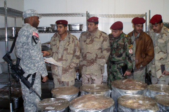 1st Lt. Cory Smith, a native of San Diego assigned to the 27th Brigade Support Battalion, 4th Brigade Combat Team, 1st Cavalry Division, teaches troops from the 10th Division Iraqi Army during a hands-on food handling class at the Coalition Dining Facility on Contingency Operating Base Adder, Iraq, Feb. 3.