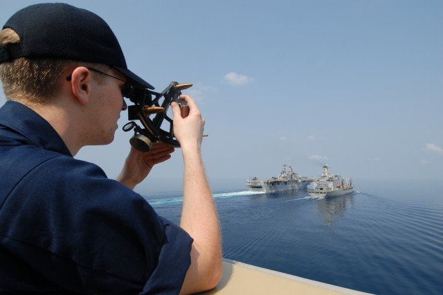 GULF OF THIALAND (Feb. 06, 2009) - Ensign Ryan Kalmore from St. Croix Falls Wis. assigned to the forward-deployed dock landing ship USS Tortuga (LSD 46) uses a stadimeter to find the distance from the Military Sealift Command (MSC) fleet replenishment oiler USNS Rappahannock (T-AO 204) as it steams alongside  the forward-deployed amphibious assault ship USS Essex (LHD 2)  during a replenishment at sea while en route to support Cobra Gold 09 (CG09). CG09 is an annual Thailand and U.S. co-sponsored joint coalition multinational military exercise designed to train a Thai, U.S. and Singaporean Coalition Task Force. The exercise will also include humanitarian civic action projects with participating nations from Indonesia , Japan, Singapore, Thailand and the U.S.; and a U.S. Thai military field training exercise.  Exercise CG provides unique and dynamic training opportunities for participating military partners, while promoting relationship building between militaries and local communities.