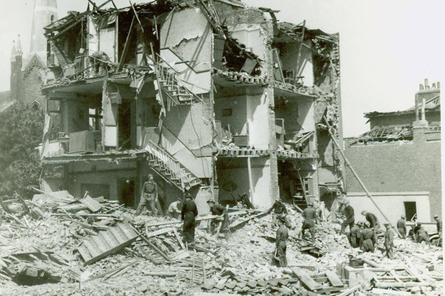Fire wardens examine debris from one of several houses wrecked by a flying bomb in London, 22 June 1944.(Paul T. Hiser Collection).