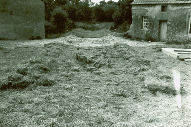 The grassy area between the two structures is a camouflaged section of track at a captured German V-weapons facility in France, 20 June 1944. (Paul T Hiser Collection).