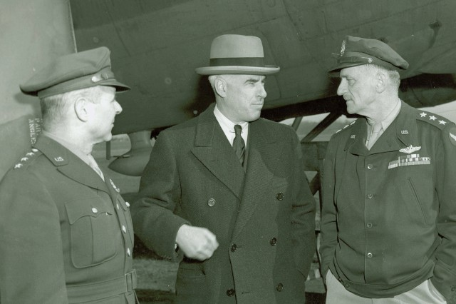 """Left to Right: LTG James """"Jimmie"""" Doolittle, Commanding General, 8th Air force; Mr. Edward R. Stettinius, Undersecretary of State and LTG Carl Spaatz, Commanding General, US Strategic Air Force, Europe, Ingrebourne, England, 20 April 1944. Generals Doolittle and Spaatz were key leaders in the strategic bombing campaign against the V-weapons. (WW2 Signal Corps Collection)."""