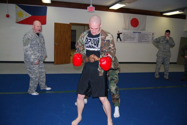 "Sgt. James Harris and an unidentified Airman perform the ""clinch drill"" on the final day of certification."