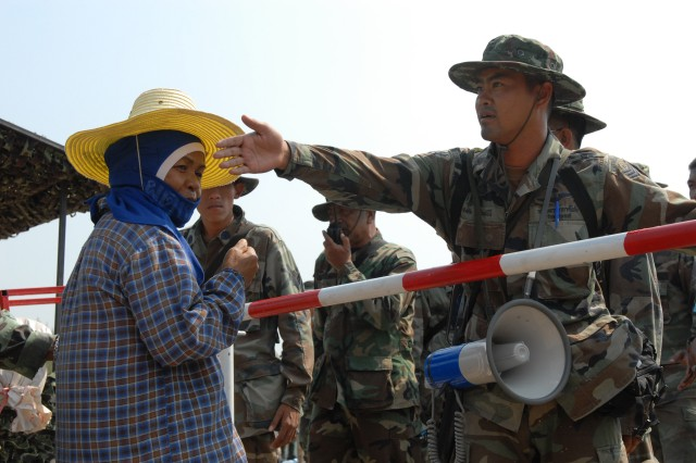 A simulated distressed villager requests the help of Soldiers from the Royal Thai Army during the disarmament, demobilization, and reintegration point security portion of the U.N.'s Global Peacekeeping Operation Initiative (GPOI). Part of Cobra Gold 09, the GPOI allows Soldiers from Thailand, Japan, Indonesia, Singapore and the U.S. to develop and execute scenarios based on actual peacekeeping experiences.