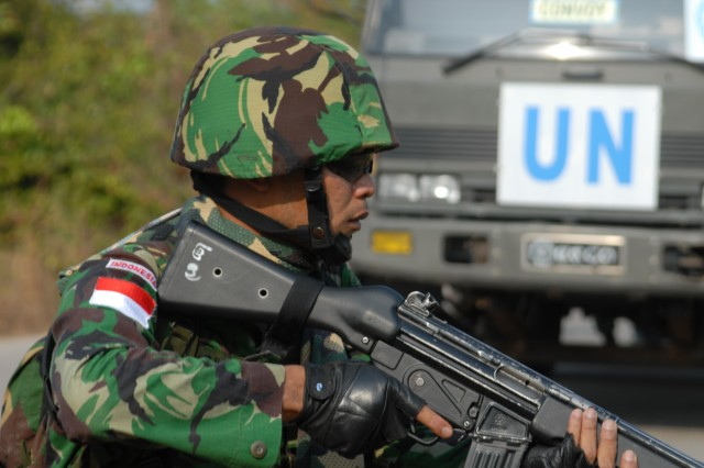 An Indonesian Army infantryman participating in the U.N..'s Global Peacekeeping Operation Initiative (GPOI), provides security for a World Food Agency truck. Part of Cobra Gold 09, the GPOI allows Soldiers from Thailand, Japan, Indonesia, Singapore and the U.S. to develop and execute scenarios based on actual peacekeeping experiences.
