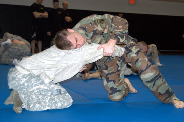 Grappling is an essential part of learning combatives, as these two Soldiers demonstrate during level 1 combative training. U.S. Army photo by Sgt. Brian K. Parker.