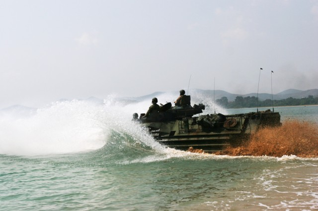 """HAD KLOD, Thailand (Feb. 9, 2009) - An Amphibious Assault Vehicle with 3rd Battalion, 5th Marines, 31st Marine Expeditionary Unit, returns to the sea after conducting an amphibious landing during Exercise Cobra Gold 2009. According to Lt. Col. Stuart Lockhart, the executive officer of the 31st MEU, the purpose of the assault was to prepare for the upcoming bilateral amphibious assault and mechanized raid training that will be conducted alongside the Royal Thai Marines Feb. 13. """"The assaults allow us to work together and approach problems during operations from a different perspective. We can work together and learn from them as the Royal Thai Marines demonstrate how they conduct AAV operations."""" Cobra Gold '09 is a bilateral exercise focusing on military interoperability training and strengthening the long-standing partnership between the Royal Thai and U.S. Armed Forces."""