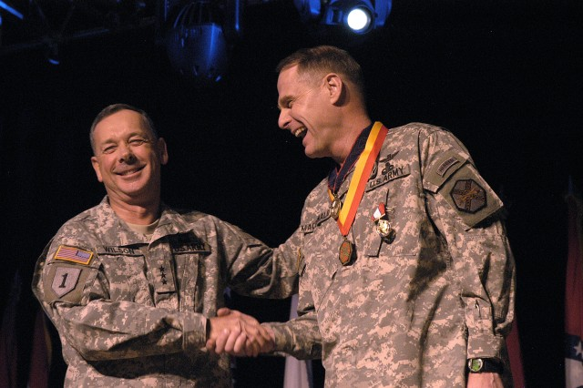 Lt. Gen. Robert Wilson, Assistant Chief of Staff for Installation Management and Commanding General of the U.S. Army Installation Management Command, shakes Maj. Gen. John A. Macdonald's hand at the Change of Command ceremony at Fort Belvoir's Wallace Theater on Friday, February 6.