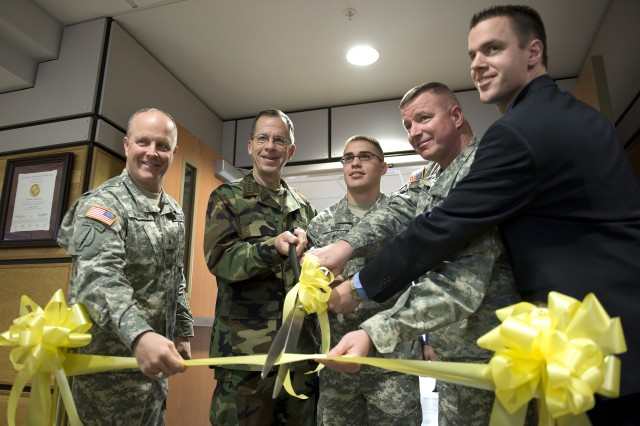From left to right, Brig. Gen. Kevin Magnum, commander, 10th Mountain Division Rear; Navy Adm. Mike Mullen, chairman of the Joint Chiefs of Staff; Pvt. Jacob Biss; Col. Jerry Penner, commander, U.S. Army Medical Department Activity; and Dr. Todd Benham, chief, Behavioral Health, participate in a ribbon-cutting ceremony for the new Behavioral Health Clinic on Fort Drum, N.Y., Feb. 9, 2009.