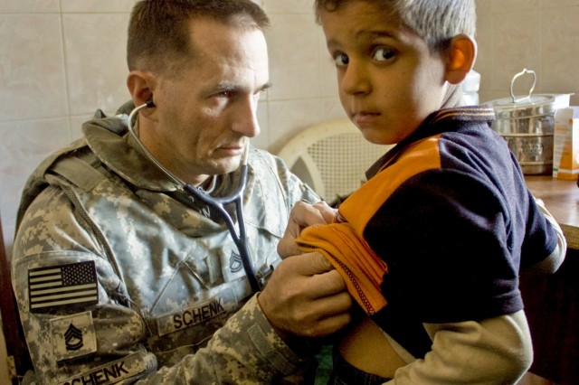 Sgt. 1st Class Mark Schenk, the medical noncommissioned officer assigned to the 1st Squadron, 9th Cavalry Regiment, 4th Brigade Combat Team, 1st Cavalry Division, listens to an Iraqi boy's chest during a combined medical engagement at a clinic near Forward Operating Base Hunter Jan. 30.