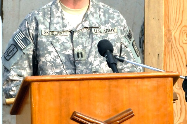 BAGHDAD - Capt. Kelly Skrdlant, of Hastings, Neb.,the commander of Headquarters and Headquarters Company, 8th Military Police Brigade, Multi-National Division-Baghdad, speaks to the crowd gathered for his change of command ceremony conducted at the 8th MP Bde. headquarters.