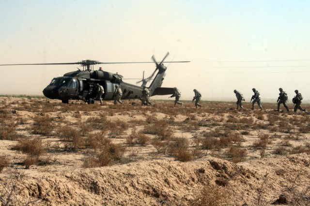 HUSSANIYAH, Iraq - Soldiers with Company A, 1st Battalion, 27th Infantry Regiment, currently attached to 3rd Brigade Combat Team, 82nd Airborne Division, Multi-National Division-Baghdad, board a UH-60 Blackhawk helicopter after completing Operation Gunslinger Bonzai XXX Feb. 3 in the Hussaniyah Nahia. The combined air assault operation was conducted with members of the 2nd Brigade, 1st Iraqi National Police Division.