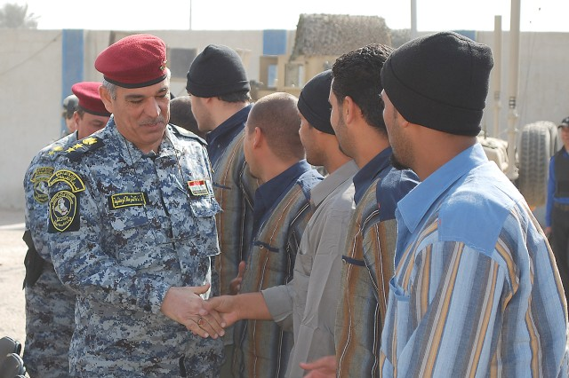 JOINT SECURITY STATION AL JADIDA, Iraq - An Iraqi National Police officer with 4th Brigade, 1st NP Division, congratulates former detainees during Operation Lions Return Feb. 7 at Joint Security Station Al Jadida located in the Al Karradah district of eastern Baghdad. NP officers told the former inmates to appreciate this day and embrace freedom.