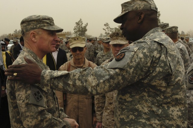 CAMP LIBERTY, Iraq - Lt. Gen. Lloyd Austin III (right), commanding general of Multi-National Corps-Iraq, says goodbye to Maj. Gen. Jeffery Hammond, commanding general of 4th Infantry Division, during the transfer of authority ceremony at Camp Liberty in Baghdad Feb. 10. The 4th Inf. Div. is heading home after completing its 15-month tour of Duty in Iraq and is being replaced by the 1st Cavalry Div.