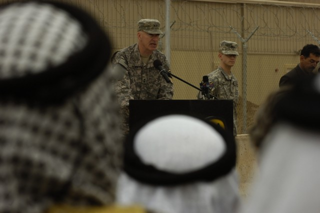 CAMP LIBERTY, Iraq - Maj. Gen. Daniel Bolger, commanding general of 1st Cavalry Division, Multi-National Division - Baghdad, addresses the audience as local Iraqi Sheiks listen during the transfer of authority ceremony at Camp Liberty in Baghdad Feb. 10. The ceremony officially marked the 1st Cav. Div. taking over the reins of the Baghdad operational environment from the 4th Infantry Div.