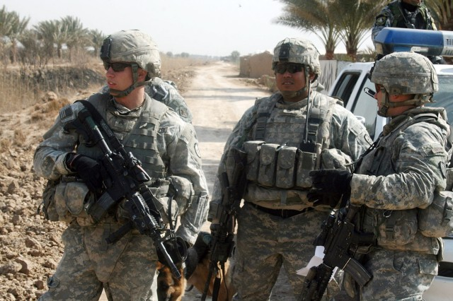 ISTAQLAL, Iraq - Sgt. George Davis (left), of Buena Vista, Colo., Staff Sgt. Davis Ni (center), of San Gabriel, Calif., and 1st Lt. Louis Cascino, of Windsor, N.Y., decide where to start searching during a combined cache clearance operation with officers from the 2nd Brigade, 1st Iraqi National Police Division Feb. 7 in the Rashidiyah Nahia, northwest of Baghdad.  All are infantrymen with Company B, 52nd Infantry Regiment, attached to 1st Battalion, 27th Inf. Regt., currently attached to 3rd Brigade Combat Team, 82nd Airborne Division, Multi-National Division - Baghdad.