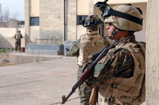 Iraqi Army Soldiers secure a school used as a polling site for Mosul's provincial elections Jan. 31. Coalition Forces were instructed to avoid the polling sites, leaving the Iraqi Security Forces to secure and maintain those neighborhoods on their