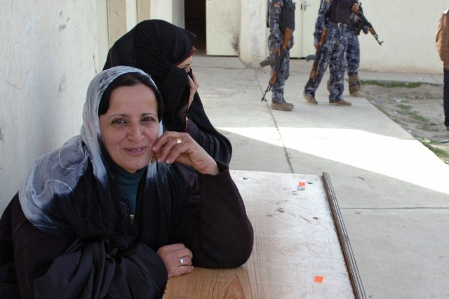 """Women were hired to perform security searches on female voters for the weekend of the Iraqi provincial elections in the Ninewa province. Schools and community buildings were used as polling sites throughout the city. """"We are thankful for the privilege to choose our own leaders,"""" one teacher said. """"Our army makes the elections possible."""""""