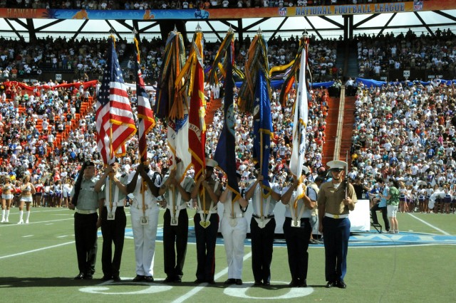 Spc. Stephen Higdon, far left, and Sgt. Marlon Nieves-Reyes, participate in the 2009 Pro Bowl pre-game festivities as members of the Joint Service Color Guard. The 8th Theater Sustainment Command Soldiers rehearsed and trained for weeks prior to the game to ensure they did not miss their mark during the National Anthem Feb. 8 at Aloha Stadium in Honolulu.