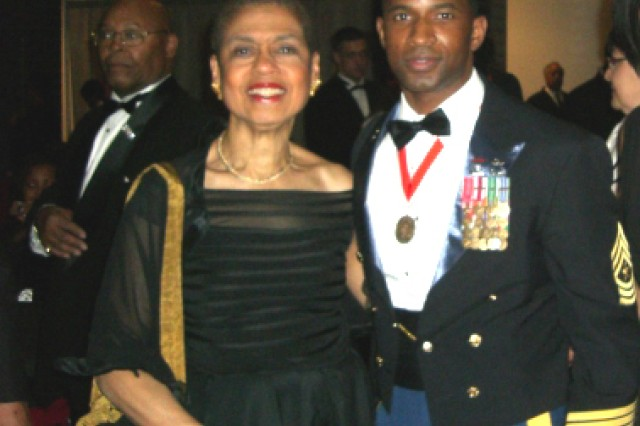 Sgt. Major Charles Hawkins, 3rd Battalion, 315th Engineer Regiment, 72nd Field Artilley Brigade, poses with Congresswoman Eleanor Holmes Norton, District of Columbia at a presidential gala in washington, D.C. Jan 19.