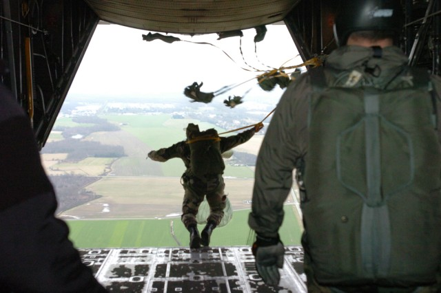 Adjudant Loic Neveu, a French parachute instructor at the French Parachute School, exits from the back tailgate of an Air Force C-130 Hercules cargo plane during a combined airborne operation at the French Parachute School Feb. 3 in Pau, France.