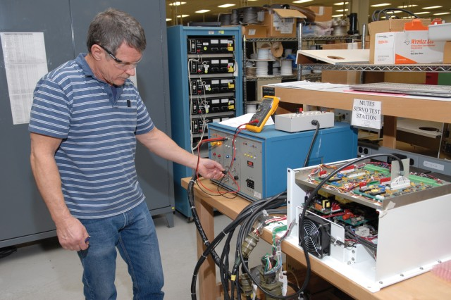 Jerry Brown, electronics mechanic, tests a MUTES servo amplifier in the maintenance support system.