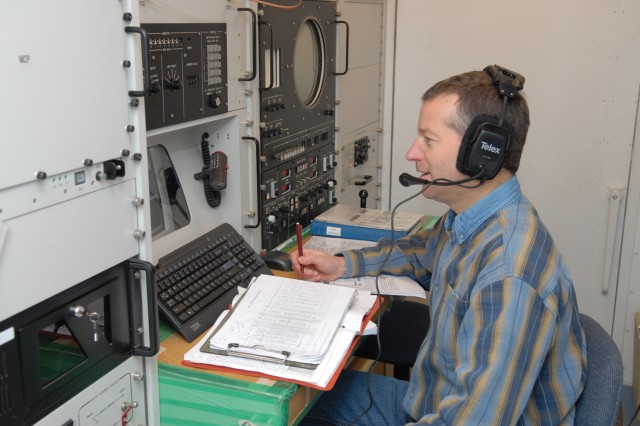 Jim Pipcho, electronics mechanic, operates the MUTES control computer.