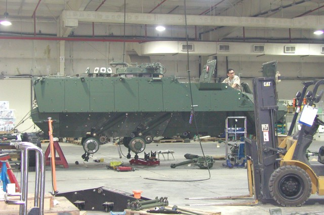 Battle damage on a Stryker is being repaired by a technician at the Stryker Repair Facility, Camp As Sayliyah, Qatar.