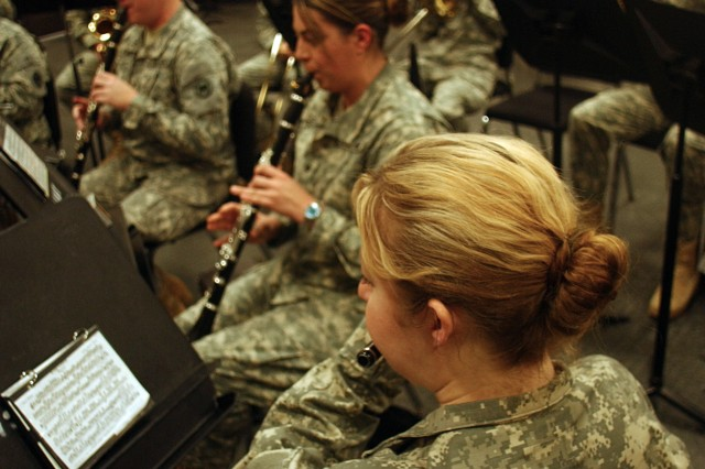 Members of the Army ReserveAca,!a,,cs 100th Army Band practice ceremonial music during a recent battle assembly at Fort Knox, Ky. The unitAca,!a,,cs ceremonial band is one of three musical support teams that perform numerous performances year round.