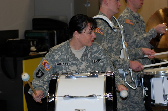 Staff Sgt. Sheri Wornath, pounds the bass drum with confidence during a rehearsal of the Army Song at a recent battle assembly at Fort Knox, Ky. The unit's ceremonial band is one of three musical support teams that perform numerous performances year round.
