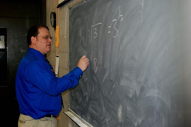Army Reserve Sgt. 1st Class Ben Rademaker explains complex mathematical equations during an early-morning Algebra class. Rademaker, a 13-year veteran teacher, belongs to 81st Regional Support Command's 100th Army Band, based out of nearby Fort Knox,